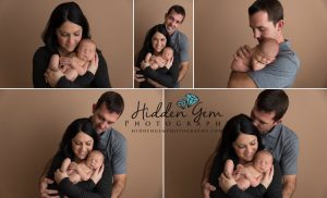 parent posing with newborn