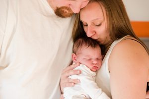 parents holding baby for lifestyle session