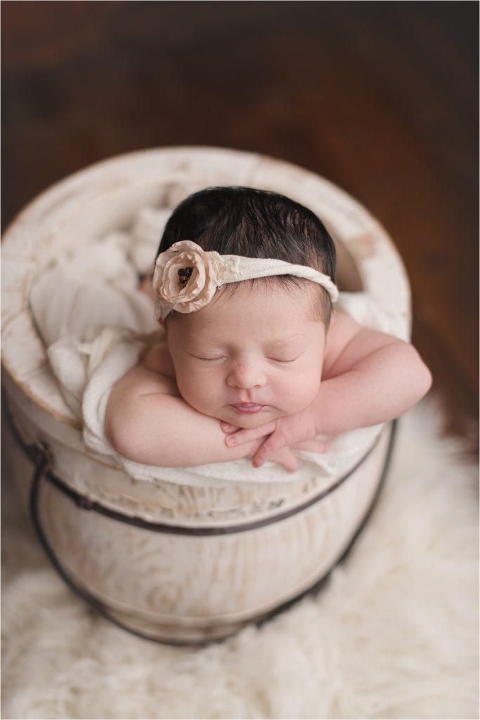 Baby girl in honey bucket