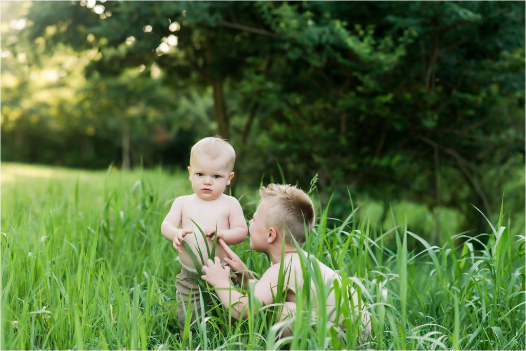 Brothers playing in the grass together in Taylorville, Il